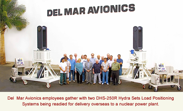 Del  Mar Avionics employees gather with two DHS-250R Hydra Sets Load Positioning Systems being readied for delivery overseas to a nuclear power plant.